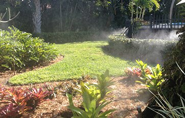 mosquito misting systems spraying a backyard from unsightly bugs